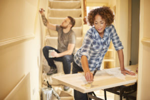 Woman and Man Re-Painting Catonsville Home Interior
