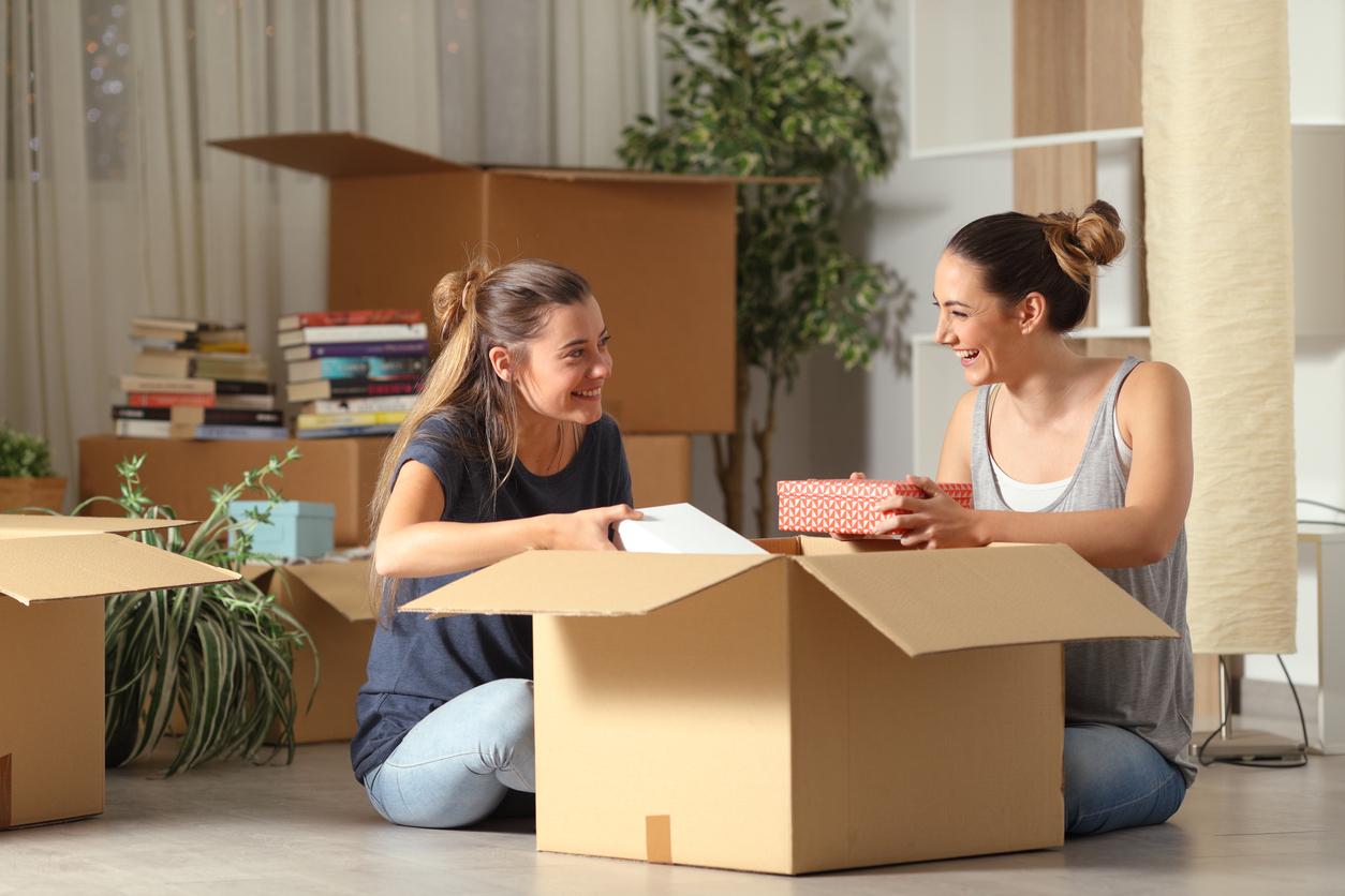 Roommates Unboxing Belongings in Fells Point Rental Home