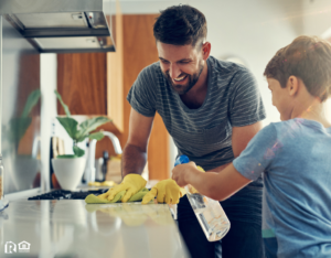 Jacksonville Family Cleaning the Stove with Organic Products