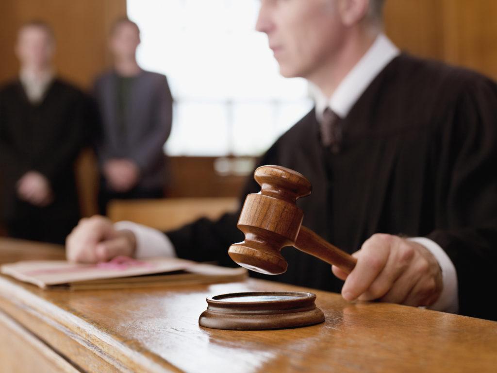 Fernandina Beach judge in a courtroom holding a gavel