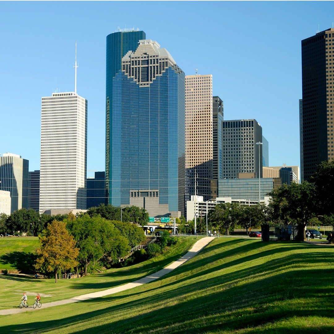 A View of the Houston Skyline Across a Park with Cyclists