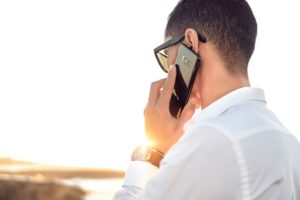 Rear View of a Man Talking on a Cell Phone