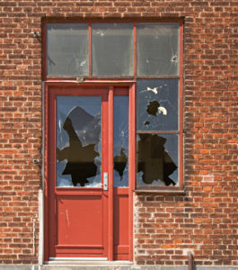 Maize Rental Property with a Broken-In Door and Windows