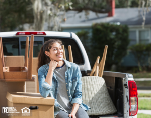 Girl Sitting in the Back of a Pickup Truck with Furniture