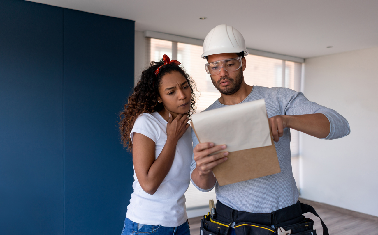 Contractor explaining a problem to a property owner while remodeling her house