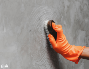 Scrubbing a Wall in a Ellsworth Rental Property