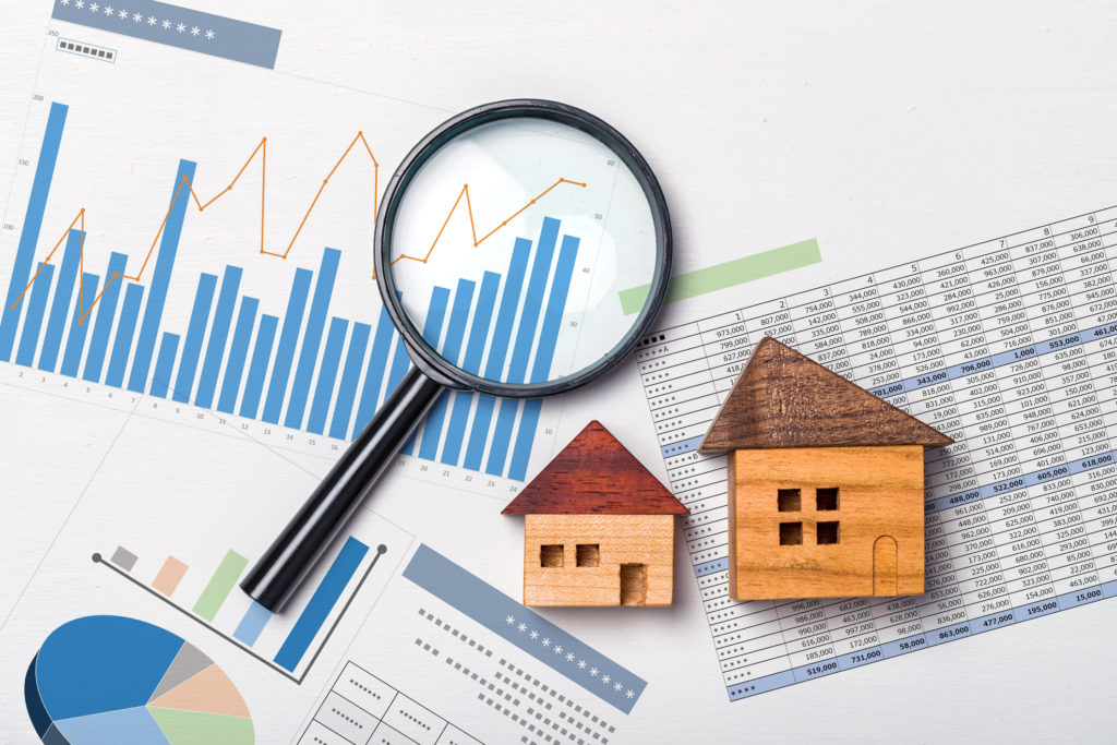 Real estate investment documents, graphs, and charts