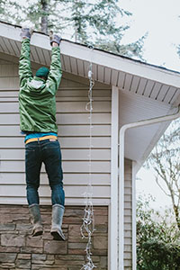 Brewer Tenant Falling While Hanging Christmas Lights