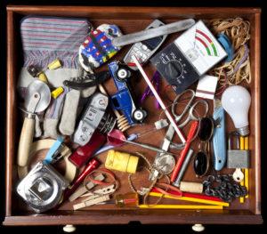 Birdseye View of a Messy Junk Drawer Full of Random Items