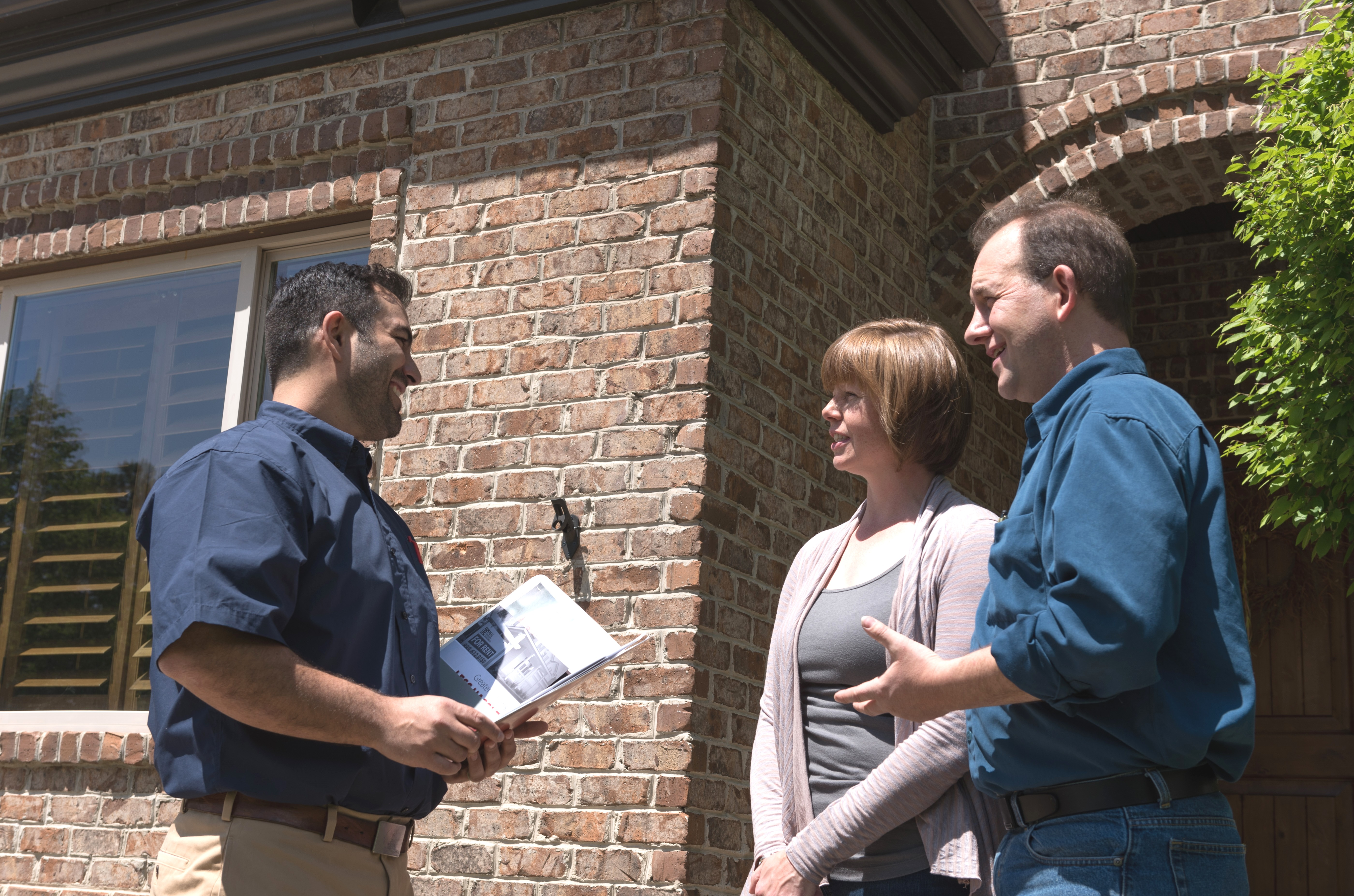 property manager and tenants having a conversation