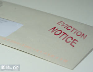 """An Envelope with an """"Eviction Notice"""" Stamp"""