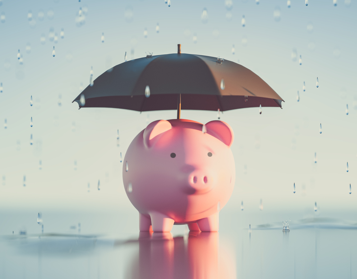 Piggy Bank with an Umbrella to Shield Against Raindrops