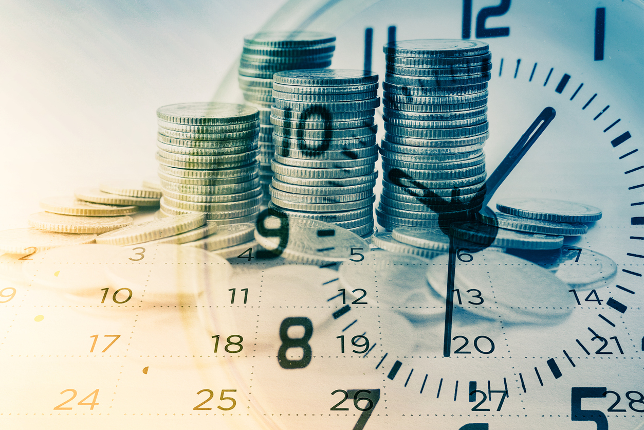 Double exposure of rows of coins with clock and calendar