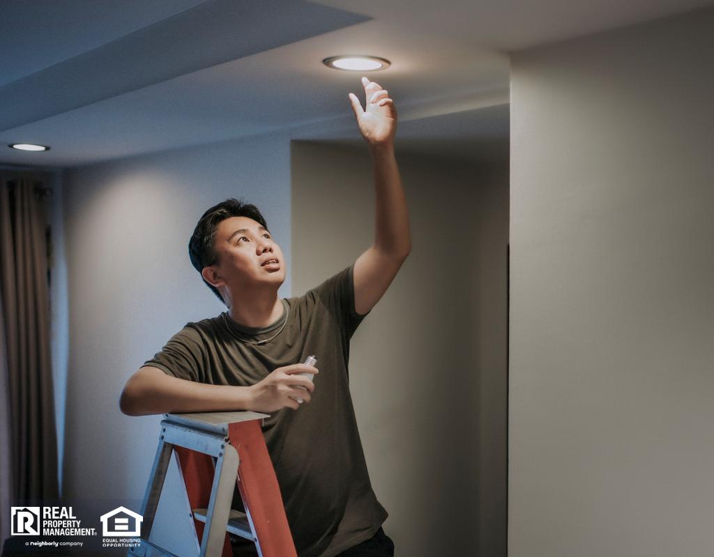 Arlington Tenant Changing a Lightbulb