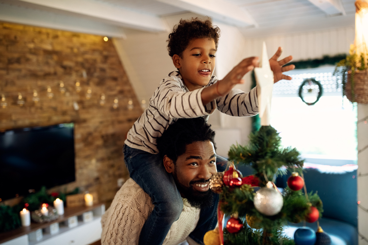 City of St. Louis Family Decorating Their Christmas Tree