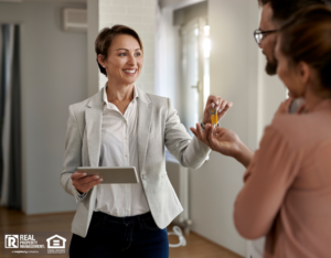 Property Manager Handing Over Keys to New Tenants