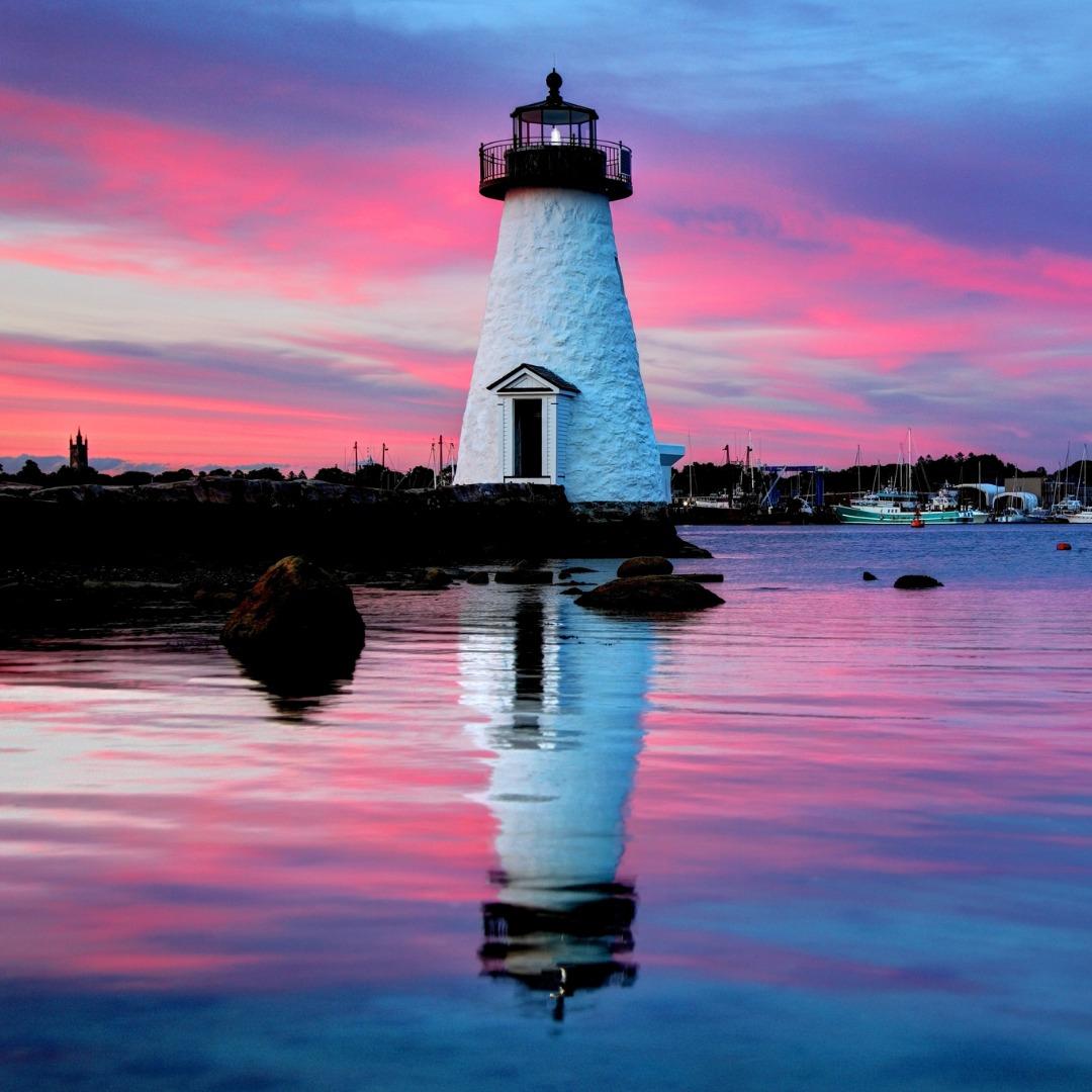 Palmer Island Lighthouse near New Bedford, MA at sunset