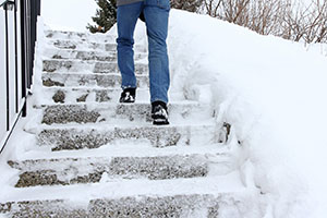 Mountain Green Tenant Climbing Dangerously Icy Steps in Winter