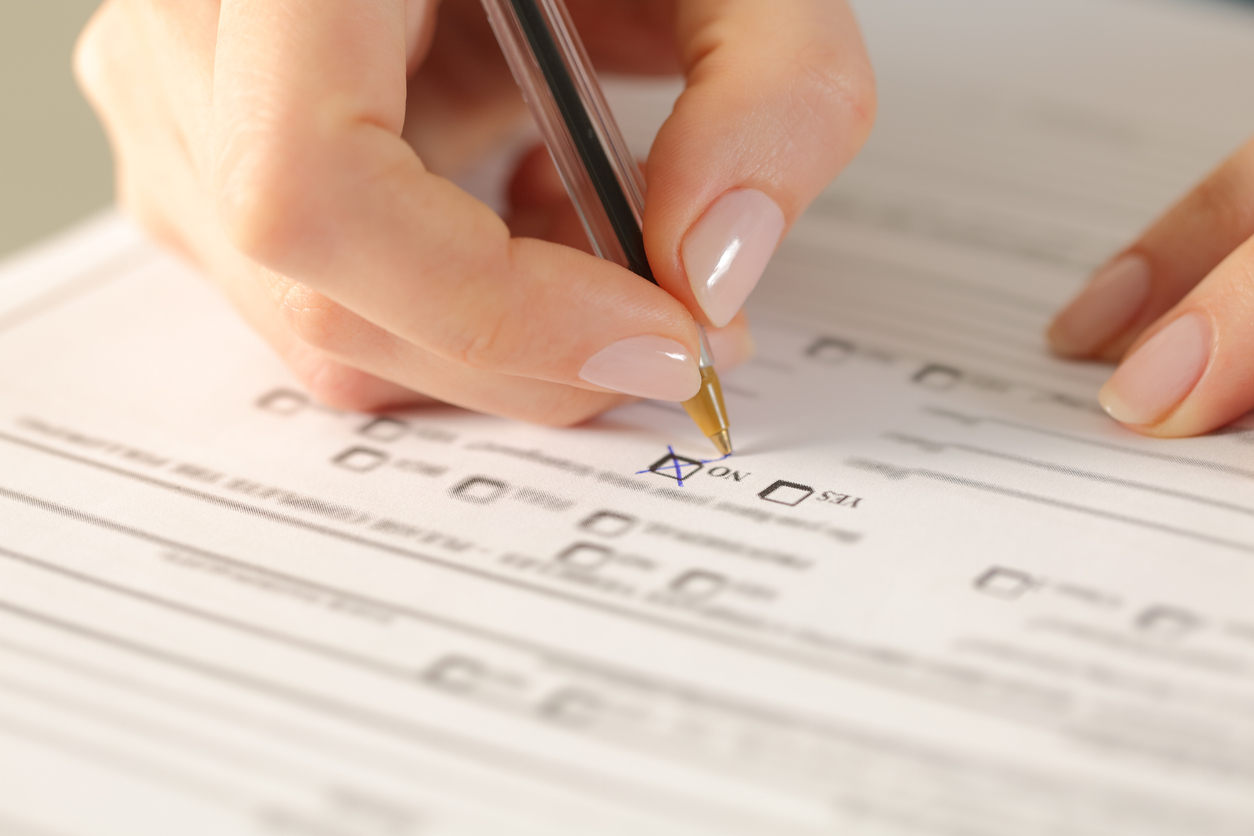 Cropped view of a Person Filling out a Checklist
