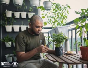 Cypress Tenant Tending his Balcony Garden