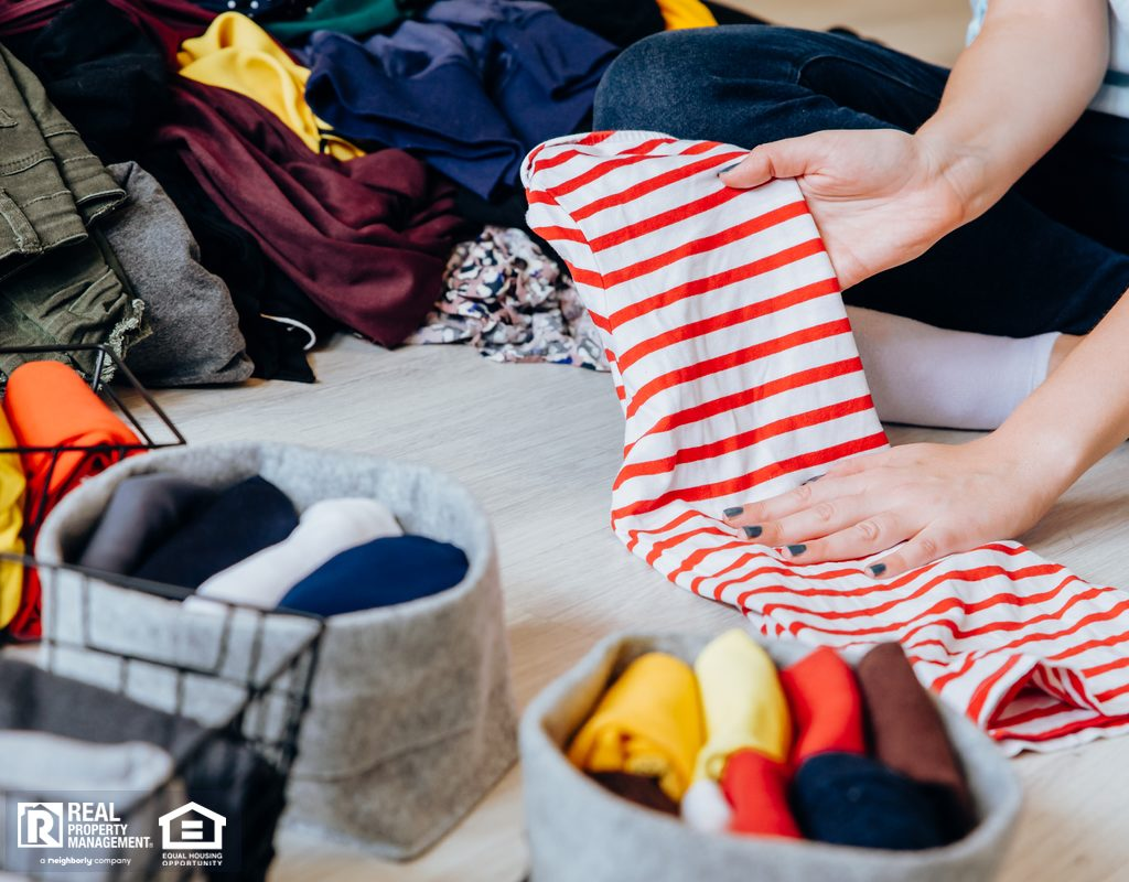 Burleson Woman Decluttering Wardrobe