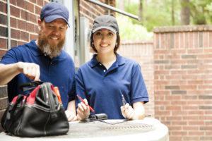 HVAC Professionals Inspecting AC Equipment