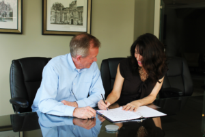 Tenant Signing a Lease for a Mars Rental Home
