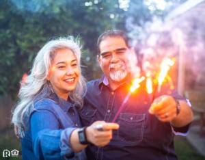 Woodstock Couple Holding Sparklers Together