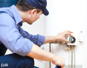 Man Fixing a Water Heater in Woodstock Rental Property