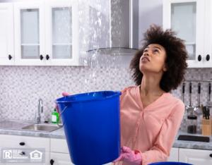 Kennesaw Tenant Holding a Bucket Under a Leak