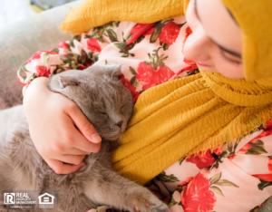 Woodstock Tenant Holding Her Cat