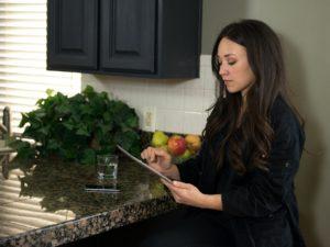 El Segundo Landlord Messaging Resident on a Tablet