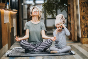 Mother and Daughter Practicing Yoga in Their Brookfield Home