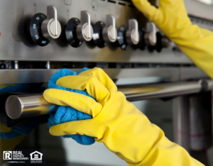 Person Scrubbing Oven with Rubber Gloves