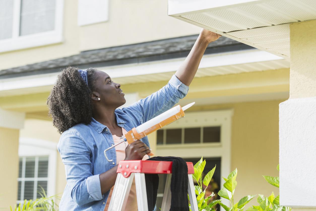 Woman Making Repairs to Her Rental Property in Sun Prairie