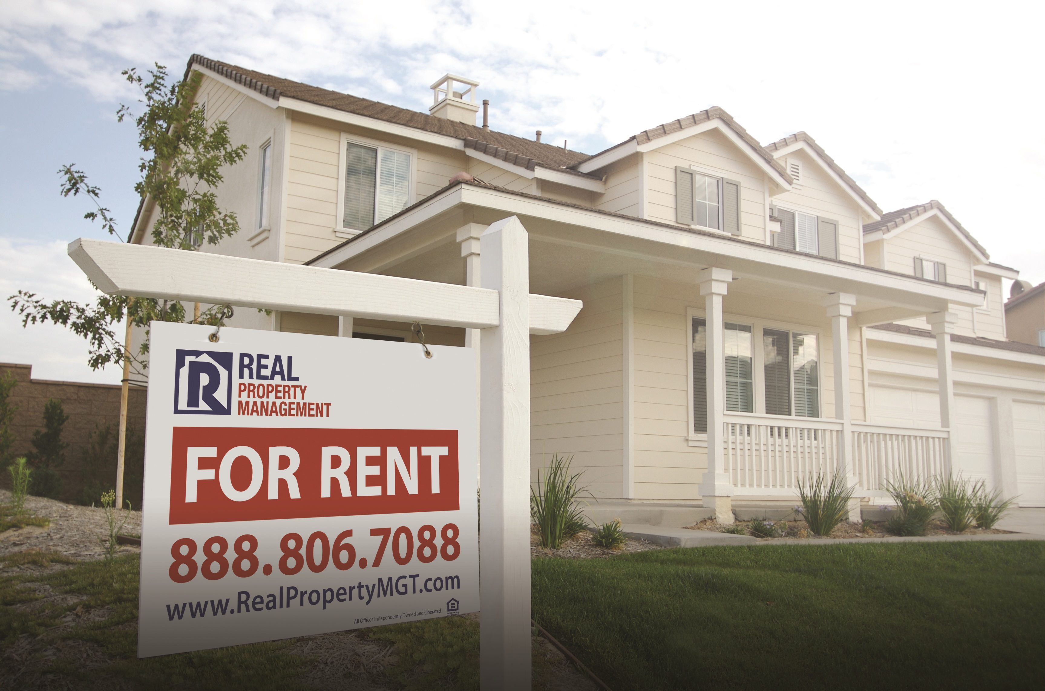 rental property with a sign in the front yard