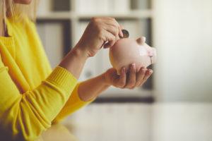 Sauk City Woman Saving Change in a Piggy Bank