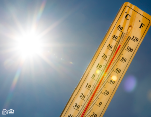 Summer heat shown on mercury thermometer against the blue sky.