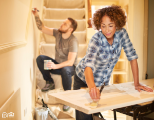Woman and Man Re-Painting De Forest Home Interior