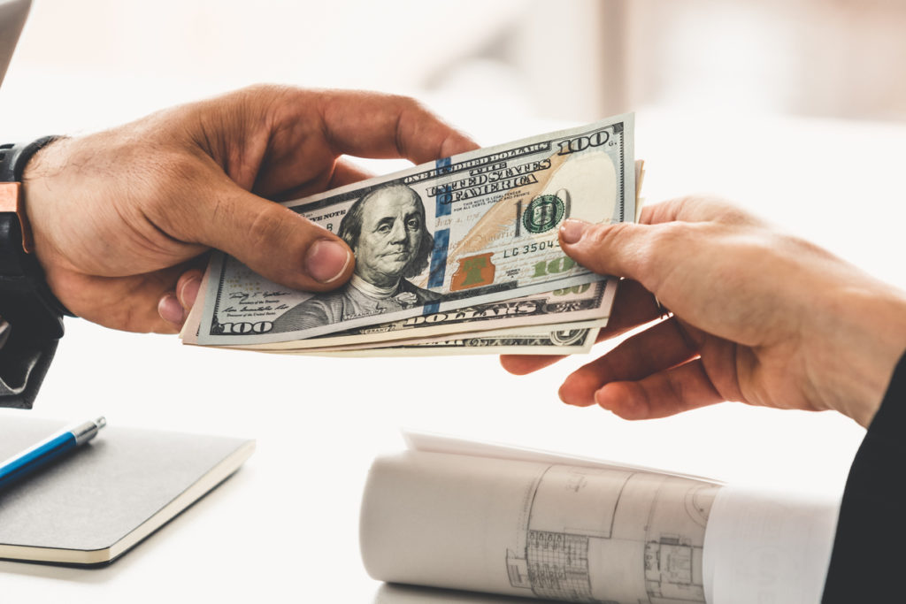 Transfer of money from hand to hand.