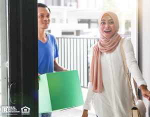 Excited couple opening the door to their new rental