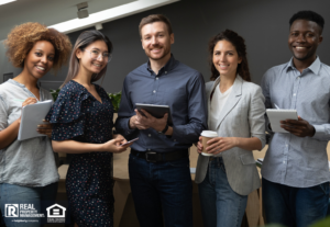 Group portrait of smiling multiethnic team posing in office
