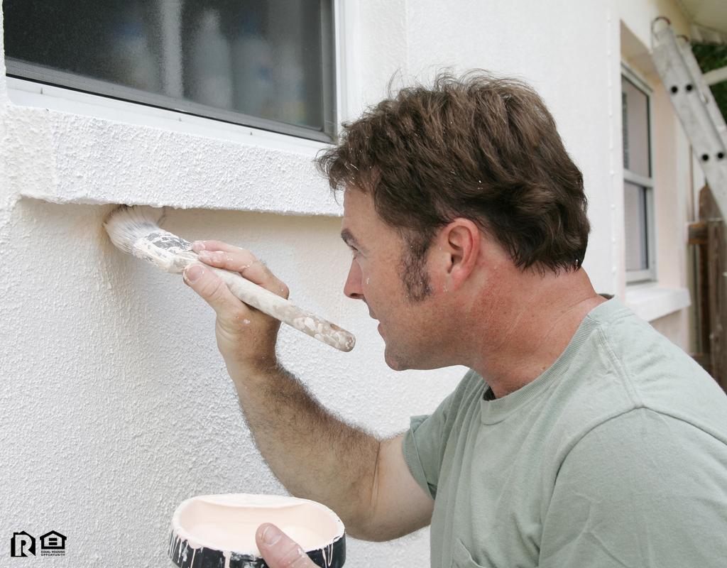 Man Painting the Exterior of a Lexington Park Rental Property