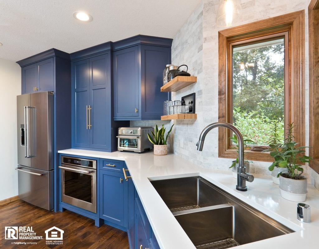 Contemporary Blue Kitchen with Renovated Windows, Cabinets, and Countertops