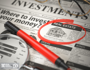 Investments Section of a Newspaper with Real Estate Circled in Red