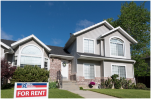 """Two-story house with """"for rent"""" sign in front yard"""
