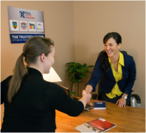 Real Property Management Metro Detroit property manager shaking hands with tenant