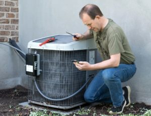 Real Property Management Metro Detroit property manager repairing the AC
