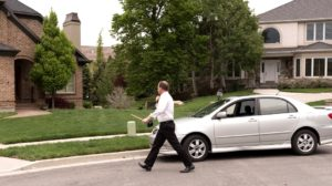 Property owner walking from car to property