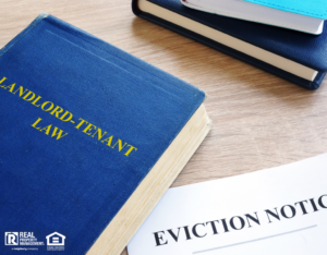 Landlord-Tenant Lawbook Next to an Eviction Notice